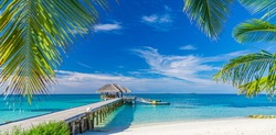 Exotic beautiful beach. Jetty on the sandy beach near the sea. Summer holiday and vacation concept for tourism. Inspirational tropical landscape. Tranquil scenery, relaxing beach, tropical landscape