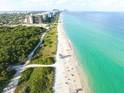 Exotic blue water beach drone photo - Exotic florida beach birds eye view
