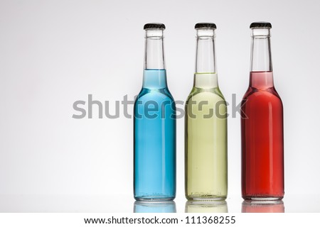 Exotic bottle alcohol cocktail isolated on white