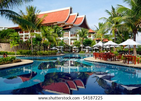 Exotic building and swimming pool with reflection. Tropical resort.