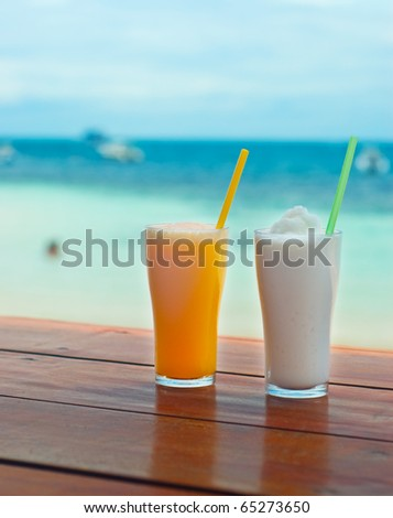 Exotic cocktail on tropical beach.