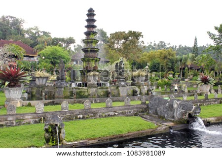 Exotic fountain and ponds with koi fishes at Tirta Gangga water palace in Bali, Indonesia #1083981089