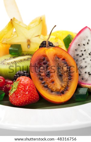 Exotic Fruit Dish with Mint Jelly. Dragon Fruit, Maracuya, Starfruit, Cantaloupe and Berries