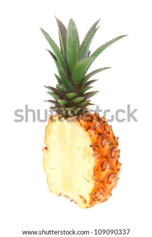 exotic fruit - fresh raw pineapple whole and half isolated over white background