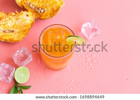 exotic fruit juice from Bel fruit or wooden Apple called in India Bel Ka Sharbat. cold fruit drink with ice on pink background. natural detox. vitamins for immunity Stock fotó ©