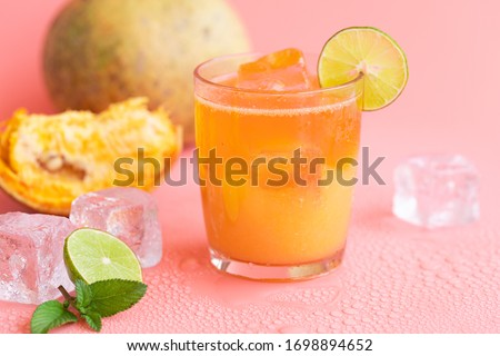 exotic fruit juice from Bel fruit or wooden Apple called in India Bel Ka Sharbat. cold fruit drink with ice on pink background. natural detox. vitamins for immunity Сток-фото ©