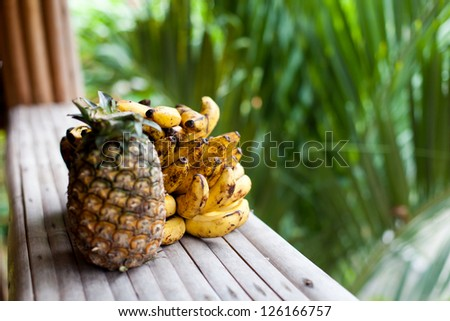 Exotic fruits closeup on wooden table
