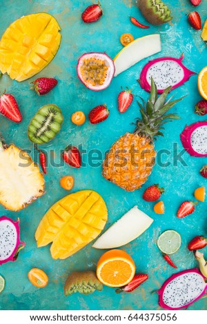 Exotic fruits on a  the turquoise background.  #644375056