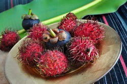 exotic fruits rambutan and mangosteen on golden plate
