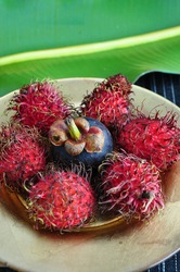 exotic fruits rambutan and mangosteen on plate