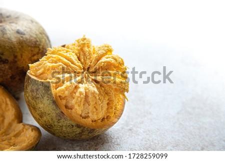 exotic Indian Bel fruit or wooden Apple. Bel fruit slices on wooden rustic background. natural detox. vitamins for immunity Сток-фото ©