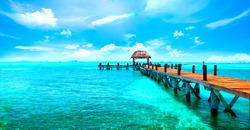 Exotic Paradise. Travel, Tourism and Vacations Concept. Tropical Resort. Caribbean sea Jetty near Cancun, Mexico.