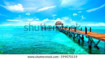 Shutterstock Exotic Paradise. Travel, Tourism and Vacations Concept. Tropical Resort. Caribbean sea Jetty near Cancun, Mexico.