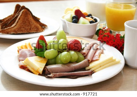 Exotic platter of oven roasted deli beef, ham, sliced turkey & chicken and assorted cheese slices. Topped with fresh strawberries and grapes. Toast, fruit bowl and orange juice complete the meal.