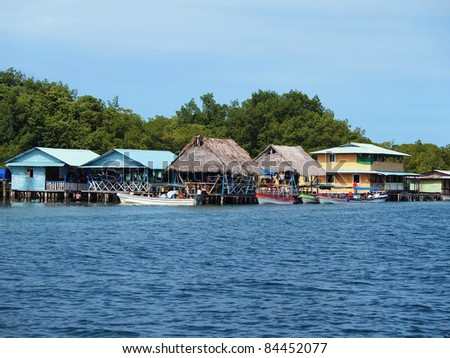 Exotic restaurant over the Caribbean sea with boats and tourists, Cayo coral, Bocas del Toro, Panama