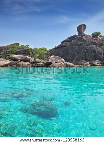Exotic Similan Islands. Warm and clear azure ocean waters. At the bottom of the bay are visible coral