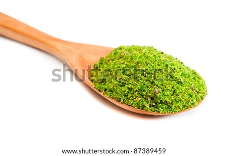 exotic spices in a wooden spoon isolated on a white backgrounds