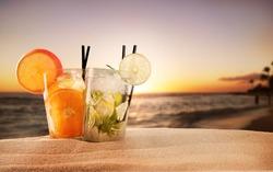 Exotic summer drinks , blur sandy beach on background