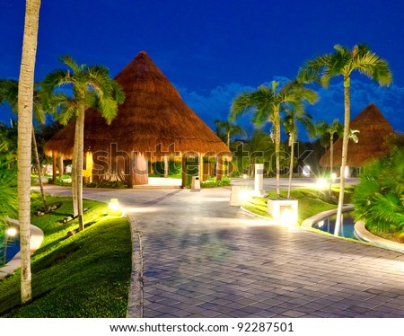 Exotic tropical bungalow ( house) at dawn (night) time. Mexico