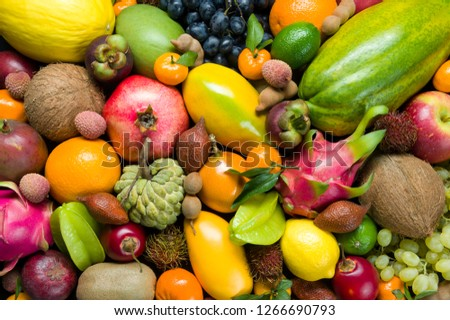 Exotic tropical fruits heap, healthy food, diet nutrition, vegetarian background #1266690793