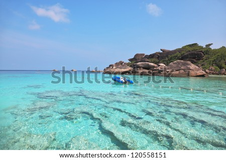 Exotic tropical Similan Islands. Clear azure ocean water. Moored in the bay inflatable boat
