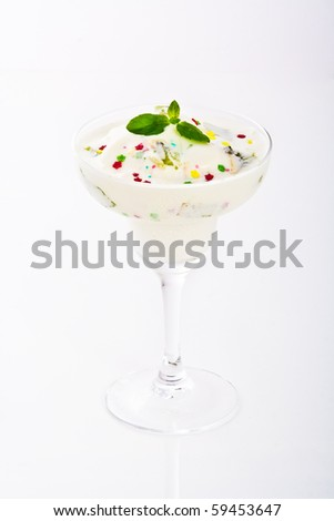 exotic vanilla ice cream with fruits and small star candies