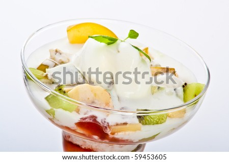 exotic vanilla ice cream with fruits served in margarita glass