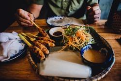 Exotic Vietnamese food with men's hands