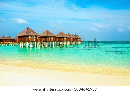 Exotic wooden houses on the water #1034641957