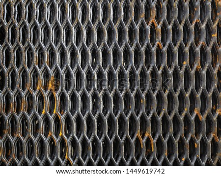 Expanded metal sheet. Metal plate with holes can be used for construction of steps or floor. Metallic texture or background