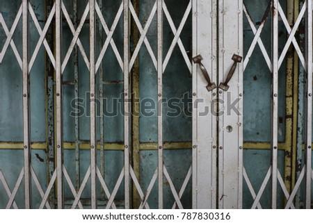 Expanded Metal Sliding Gate. Old Style Grunge Metal Door. Rustic Expanded Metal  Shutter Door
