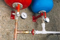 expansion tanks with pressure gauges in boiler room