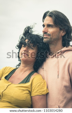 expectant couple facing into...