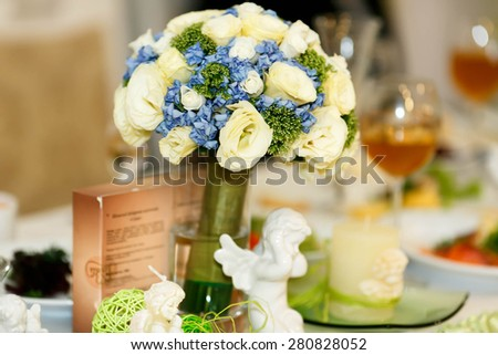 expencive fancy bouquet with beautiful blue and pastel roses