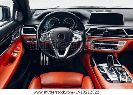 Expensive car interior with steering wheel, multimedia dashboard and gearbox handle Photo stock ©