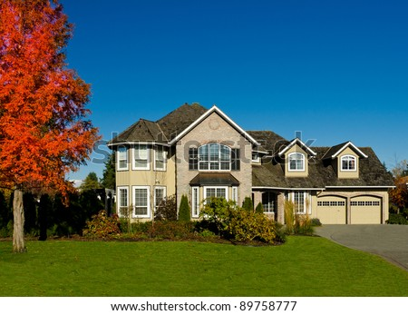 Expensive luxury home against a blue sky in a autumn season