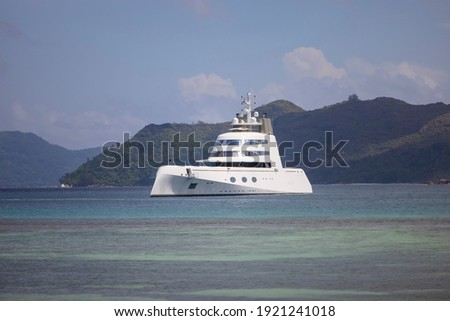 Expensive stealth luxury super yacht moored off Curieuse island in the Seychelles Stock photo ©