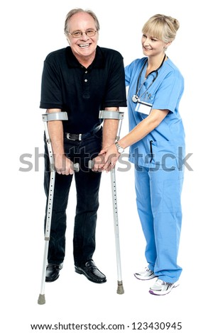 Experienced physician assisting her patient in recovery process. Isolated on white.