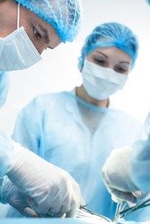 Experienced surgical team is doing their work