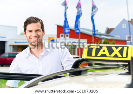 Experienced taxi driver in front of his taxi waiting for a passenger