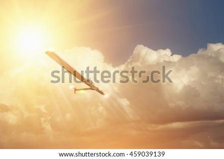 Experimental aircraft on sun energy. Solar Impulse in cloudy sky with sunlight  #459039139