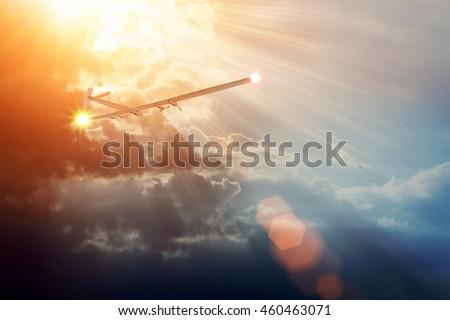 Experimental aircraft on sun energy. Solar Impulse in cloudy sky with sunlight #460463071