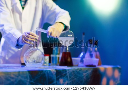 Experiments in a chemistry lab. conducting an experiment in the laboratory. #1295410969