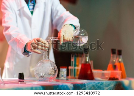 Experiments in a chemistry lab. conducting an experiment in the laboratory. #1295410972