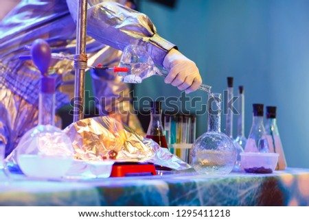 Experiments in a chemistry lab. conducting an experiment in the laboratory. #1295411218