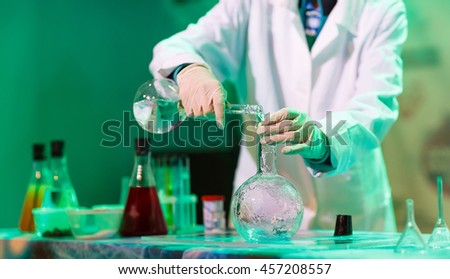 experiments in a chemistry lab. ...