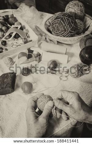 Expert hands crafting traditional sport balls