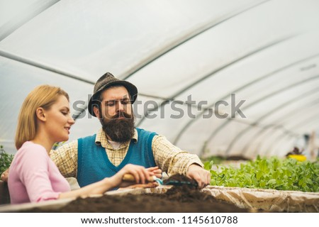 expert in greenhouse. couple of expert in greenhouse. expert working in greenhouse. expert of greenhouse industry. i have the best job in the world #1145610788