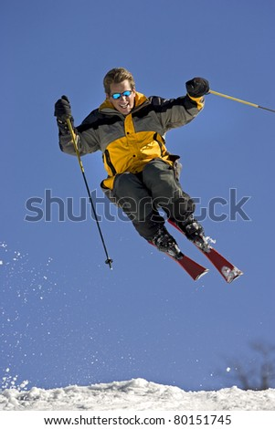 Expert snowboarder in mid-air making jump.