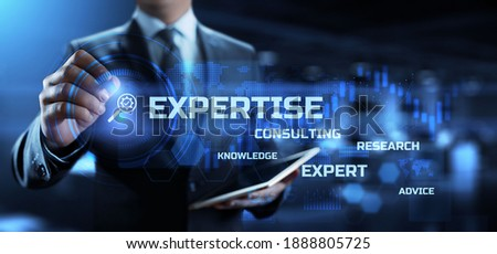 Expertise, expert, consulting, knowledge, advice. Business and development concept. Businessman pressing button on virtual screen. Сток-фото ©